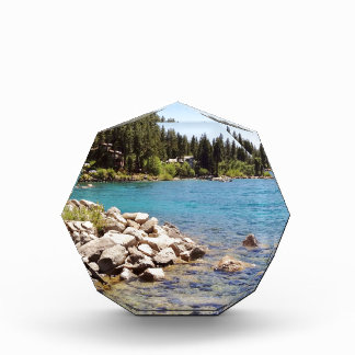Lake Tahoe's clear waters with snowy mountains Award