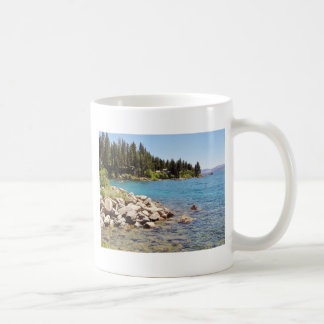 Lake Tahoe's clear waters with snowy mountains Coffee Mug