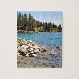 Lake Tahoe's clear waters with snowy mountains Puzzle