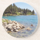 Lake Tahoe's clear waters with snowy mountains Sandstone Coaster