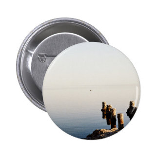 Lake Themed, A Bunch Of Wooden Pillars Buried In A 2 Inch Round Button