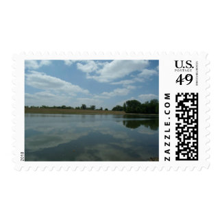 Lake Water Reflects the skies Fluffy White Clouds Postage Stamp