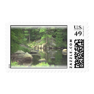 Lake with rocks postage stamp