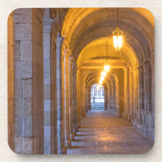 Lamp lit stone hallway, spain beverage coaster