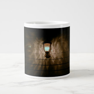 lamp with angel wings reflection on wall giant coffee mug
