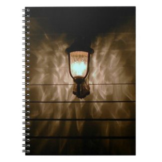 lamp with angel wings reflection on wall note books