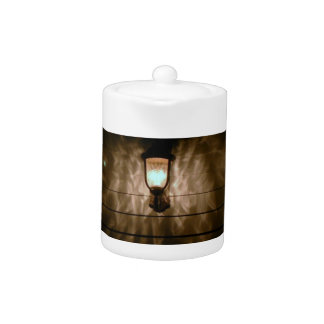 lamp with angel wings reflection on wall teapot
