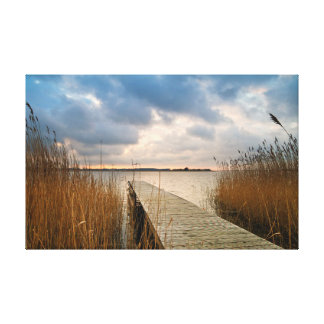 Landing stage on a lake stretched canvas print