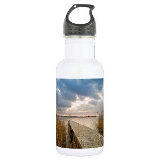 Landing stage on a lake water bottle