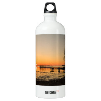 Landing stage on a lake with sunset aluminum water bottle