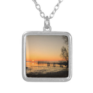 Landing stage on a lake with sunset necklaces