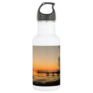 Landing stage on a lake with sunset water bottle