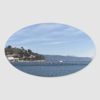 Landscape of Golfo Dei Poeti with its mussel farm Oval Sticker