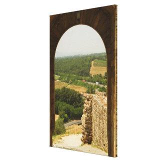 Landscape viewed through an archway, Porta Canvas Print