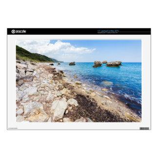 "Landscape with boulders and rocks on coast 17"" laptop skins"