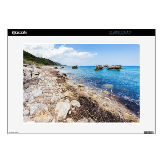 Landscape with boulders and rocks on coast skin for laptop