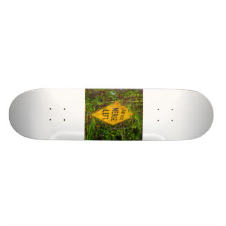 Lane Ends. Merge Left. Bright yellow roadsign Skateboard Deck