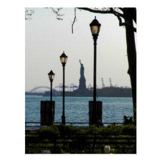 Lanterns Framing Statue of Liberty at Battery Park Postcard