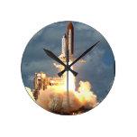 Lanzamiento de la lanzadera reloj de pared