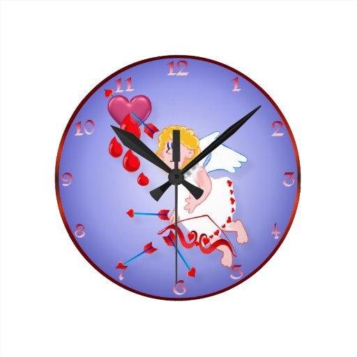 Lanzamientos del Cupid para el corazón Relojes De Pared