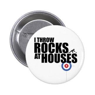 Lanzo rocas en encresparse de las casas pin redondo de 2 pulgadas