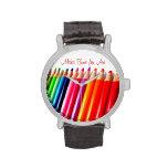 Lápices coloreados relojes
