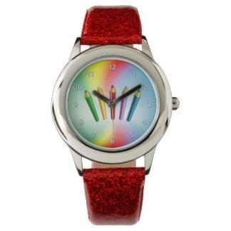 Lápices del color relojes de pulsera