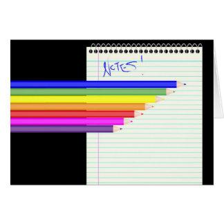 Lápices y cuaderno tarjeta de felicitación