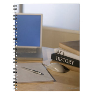 Laptop computer and textbooks note book