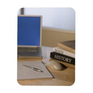 Laptop computer and textbooks rectangular photo magnet