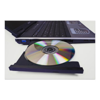 laptop computer with open optical disk drive poster