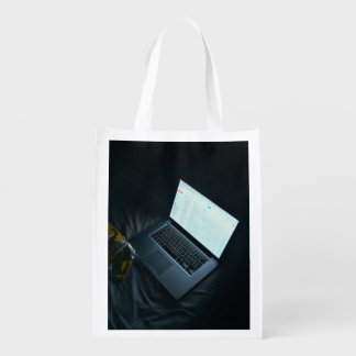 Laptop Themed, Glowing Laptop Screen On An Unmade Market Totes