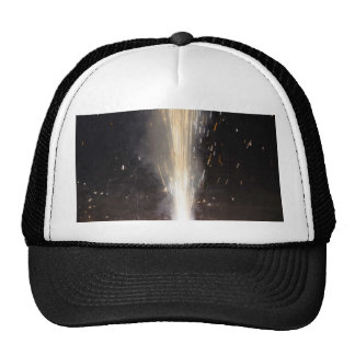 Large amount of sparks from a firecracker trucker hat