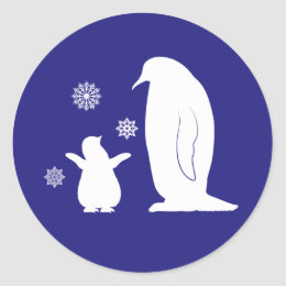 Large and Small Penguin in Silhouette in the Snow Classic Round Sticker