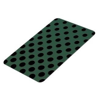 Large black polka dots on dark green magnet