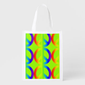 Large colorful rainbow peace signs on apple green reusable grocery bag