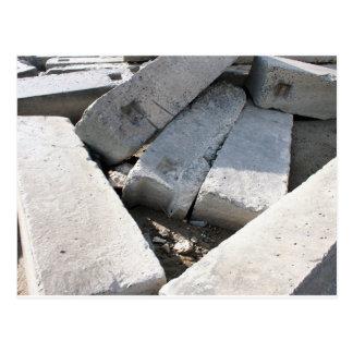 Large concrete building blocks closeup postcard