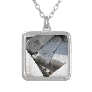 Large concrete building blocks closeup square pendant necklace