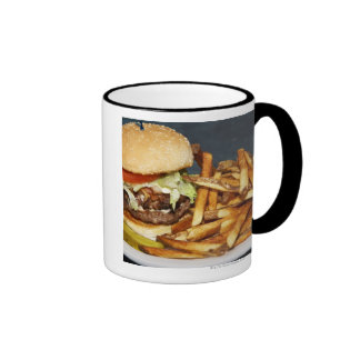 large double half pound burger fries and cola coffee mugs