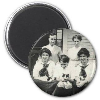 Large family holding cats fridge magnets