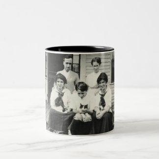 Large family holding cats mug
