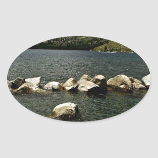 LARGE GRANITE BOULDERS IN A MOUNTAIN LAKE OVAL STICKER