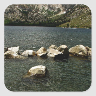 LARGE GRANITE BOULDERS IN A MOUNTAIN LAKE SQUARE STICKER