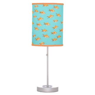 Large group of goldfish facing one lone goldfish lamp