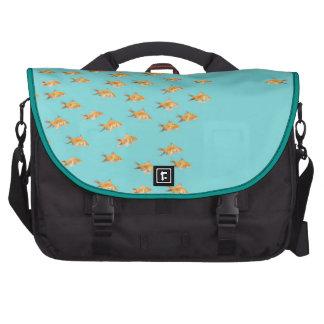 Large group of goldfish facing one lone goldfish laptop bag