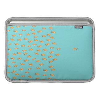Large group of goldfish facing one lone goldfish MacBook air sleeve