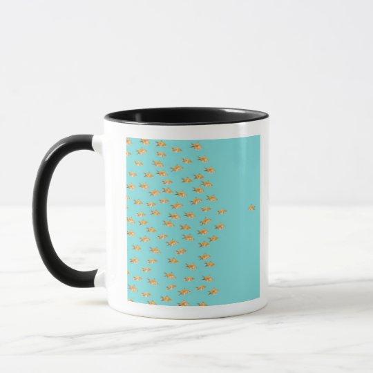 Large group of goldfish facing one lone goldfish mug