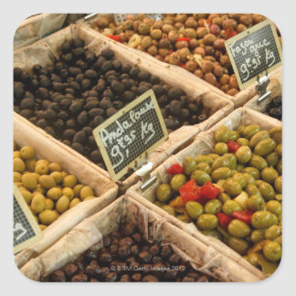 Large open boxes of black and green olives for square sticker