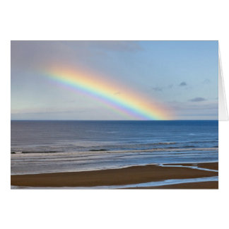 Large rainbow over the Pacific Ocean at Card