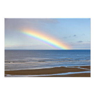 Large rainbow over the Pacific Ocean at Photo